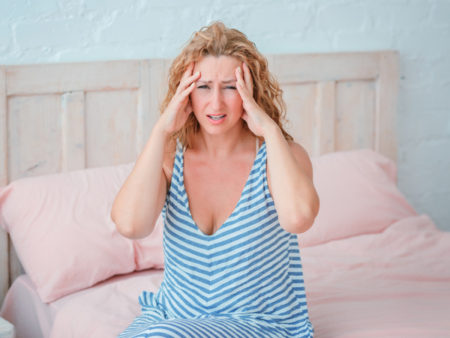 perimenopause mayhem woman on bed